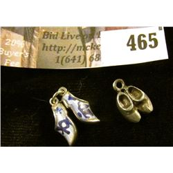 (2) pairs of silver Dutch wooden shoe charms, one with inlaid Delft style enamel. Definitely differe