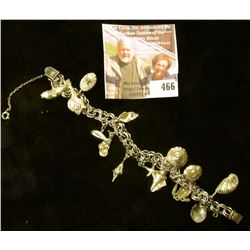 """8"""" silver double ring link charm bracelet with 14 shells and whales sterling charms. Well made with"""