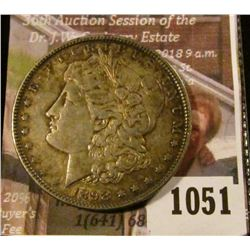 1051 . 1898 Morgan Silver Dollar, BU toned, full breast feathers, c