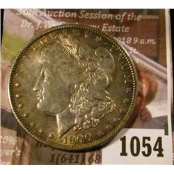 1054 . 1900-O Morgan Silver Dollar, AU toned, reverse has old bulls