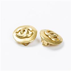 CHANEL Round Logo Embossed Clip Earrings