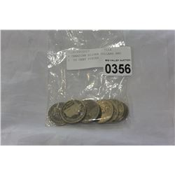 6 CANADIAN SILVER DOLLARS AND 3 50 CENT PIECES
