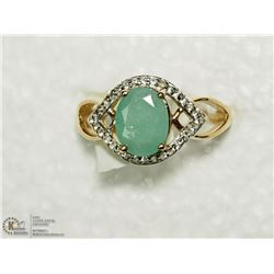 35) SILVER EMERALD AND CUBIC ZIRCONIA RING