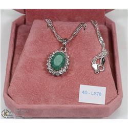 40) SILVER LARGE EMERALD AND SIDE TOPAZ NECKLACE