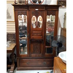 ANTIQUE MAHOGANY WARDROBE W/CARVED DETAILS AND BEVELLED MIRRORS