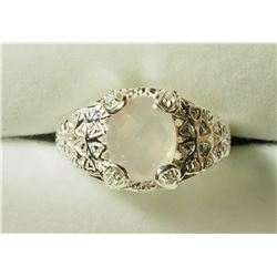 STERLING SILVER ROSE QUARTZ RING. APPROX RETAIL $120