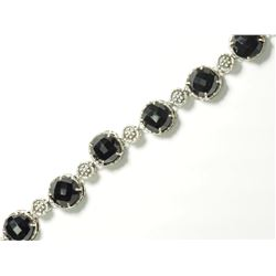 STERLING SILVER BLACK ONYX ANTIQUE DESIGN BRACELET(28G). APPROX RETAIL $600