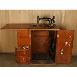 Antique Sewing Machine & Cabinet