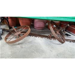 2 ANTIQUE STEEL WHEELS AND 5FT SAW BLADE
