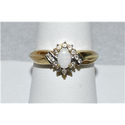 Vintage Womens 14K Opal center stone and diamond ring, 15 stones total