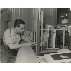 Vincente Minnelli photograph constructing stage design maquette by Alfred Eisenstaedt.