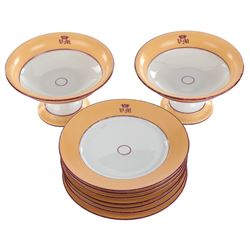 Vincente Minnelli (8) monogrammed plates and (2) pedestal compotes.