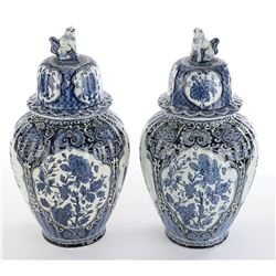 Vincente Minnelli (2) Delft Royal Sphinx Maastricht lidded vases with foo dog finials.