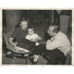 Judy Garland (4) photographs on-set with Vincente Minnelli and baby Liza.