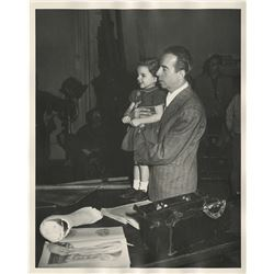 Judy Garland and Vincente Minnelli (2) photgraphs on-set with little Liza Minnelli.