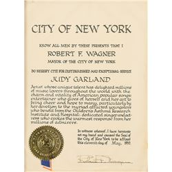 Judy Garland award proclamation from New York City mayor Robert F. Wagner in presentation folder.