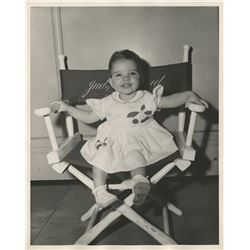 Liza Minnelli (2) childhood photographs sitting in her mother's directors chair.