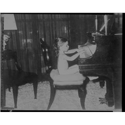Liza Minnelli negative at the piano.