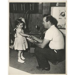 Liza Minnelli (10) childhood photos on set with actors including Lucille Ball, Fred Astaire & more.
