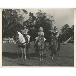 Liza Minnelli childhood photograph riding a pony with friends.