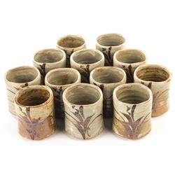 Liza Minnelli collection of (12) hand thrown pottery cups