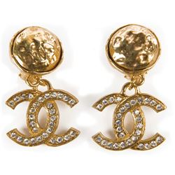 Liza Minnelli Chanel gold tone earrings.