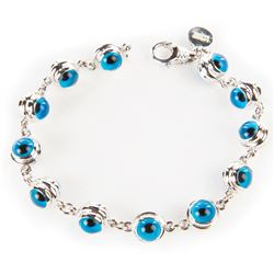 Liza Minnelli Aaron Basha 18k white gold tennis bracelet with eye motif.
