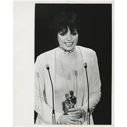 Liza Minnelli (100+) photographs receiving awards including Oscar, Tony, Golden Globe, and more.
