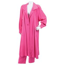 Liza Minnelli fuchsia topcoat ensemble and golden kaftan.