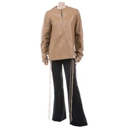 Liza Minnelli tan leather jacket by Halston with black pants.