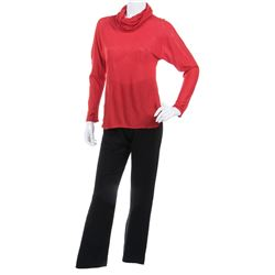 Liza Minnelli red turtleneck knit top with black pants by Halston.