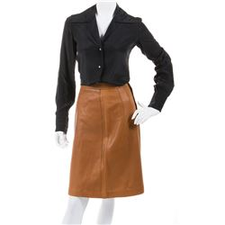 Liza Minnelli caramel leather skirt with black blouse by Halston.