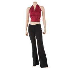 Liza Minnelli black pants with wine colored halter and blouse by Halston.