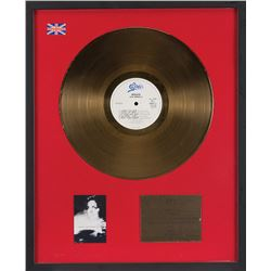 Liza Minnelli framed gold record 'Results' recognizing UK album sales.