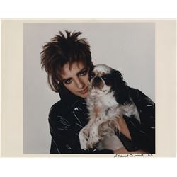 Liza Minelli (60+) photographs and Polaroids with her dogs.