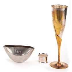 Liza Minnelli (3) engraved metal pieces including champagne flute, napkin ring, and bud vase.