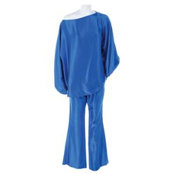 Liza Minnelli 2014 Academy Awards ceremony blue satin pantsuit ensemble by Halston.