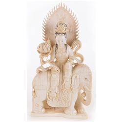Liza Minnelli Kwan Yin with headdress and lotus seated on elephant hand-carved bone figure.