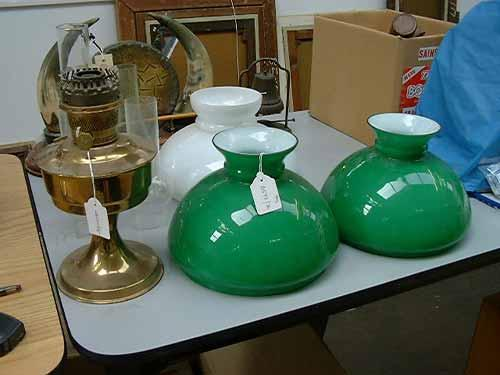 An early 20th century brass aladdin oil lamp two green glass shades image 1 an early 20th century brass aladdin oil lamp two green glass shades aloadofball Images