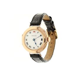 WATCH:  [1] 9 karat rose gold ladies vintage Rolex watch with a white ceramic dial and '12' in red e