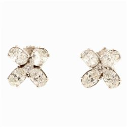 EARRINGS:  [1 pair] 18 karat white gold flower motif earrings set with 2 round and 8 oval cut diamon
