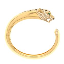 BRACELET:  [1] 18 karat yellow gold Panthere de Cartier hinged cuff style bangle bracelet set with 3