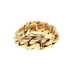 BRACELET: [1] 10kt yellow gold Cuban link bracelet; 8.5 inches long x 1 inch wide, double safety cla
