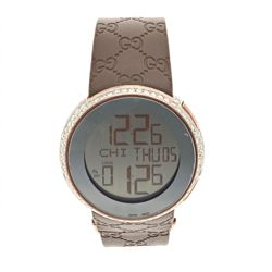 WATCH: [1] Gucci watch, digital movement, bronze tone case, 2 button on side, brown strap, serial #1