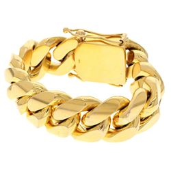 BRACELET: [1] 10ky stamped Cuban link bracelet; 9 inches long, 25mm wide, box clasp with two safetie