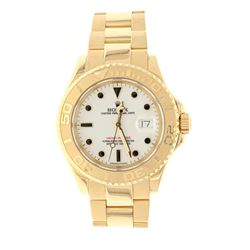 WATCH: [1] Man's 18KYG Rolex Oyster Perpetual Yacht Master, DateJust, white dial black markers, 43mm