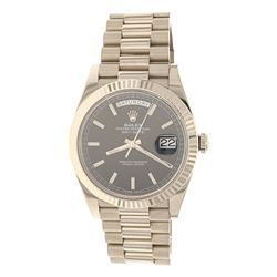 WATCH: [1] Man's 18KWG Rolex Oyster Perpetual Day/Date, black dial stick markers, fluted bezel, watc