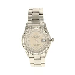 ROLEX: St.steel Rolex Oyster Perpetual DateJust watch, 36mm case, champagne dial with diamond accent