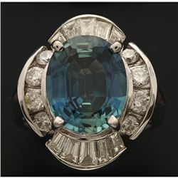 RING: 14k white gold ring; size 6; (1) oval mixed cut blue sapphire, 11.93mm x 9.75mm x 5.11mm = an