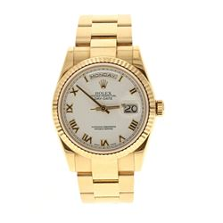 ROLEX: 18k yellow gold Rolex DayDate President; 36mm case, white dial with roman numerals, fluted be